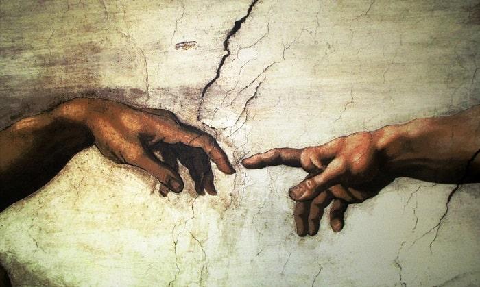 """""""Mâna lui Dumnezeu"""" - parte din pictură pe tavaul Capelei Sixtine"""